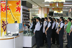 Photograph of a staff briefing at a Japanese invested store in China